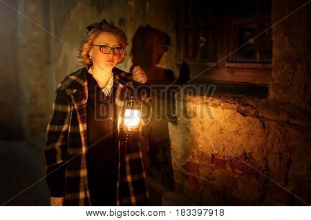 Beautiful Blonde Female Detective With Vintage Lantern In Retro Coat Walking In Old French Street, M
