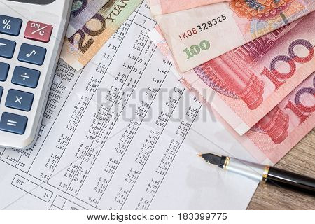 Budget Text With Calculator, Yuan And Pen On Desk.