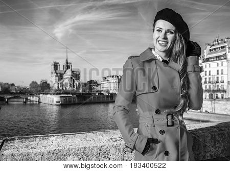 Smiling Woman On Embankment In Paris Looking Into The Distance