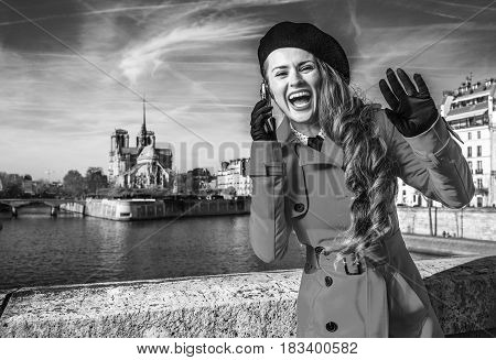 Woman On Embankment In Paris Talking On Cellphone And Handwaving