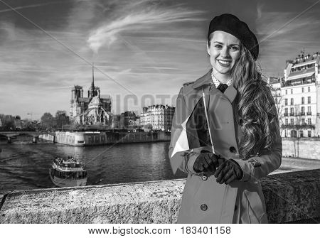 Woman On Embankment Near Notre Dame De Paris With French Flag