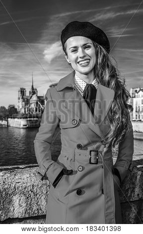 Smiling Tourist Woman Standing On Embankment In Paris, France