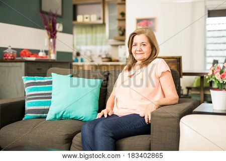 Happy Grandmother Sitting In The Living Room