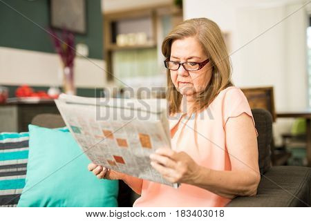 Aged Lady Reading Newspaper