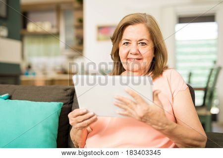 Elderly Woman Using A Tablet Computer