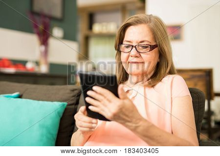 Happy Woman Wearing Her Glasses To Read