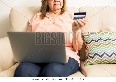 Mature Woman Checking Her Personal Finances Online