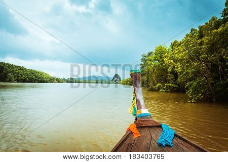 Traditional wooden longtail boat on Pak Nam Krabi river, Thailand