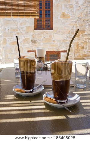 Two latte macchiatos served in an old cafe in Greece