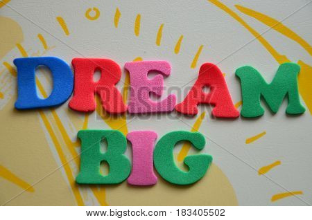 word dream big on a  abstract col.orful background