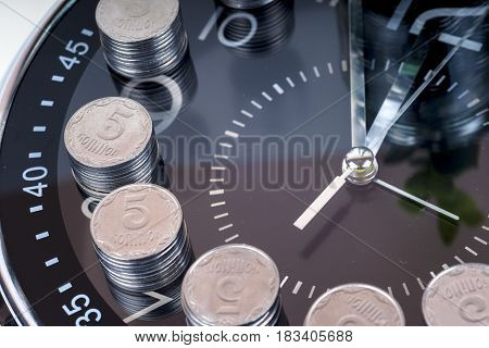 coins with clock isolated on white background. savings concept concept of time and money. copy space for text.