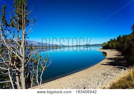 Jackson Lake with the landscape perfectly reflected in Grand Teton National Park in Wyoming