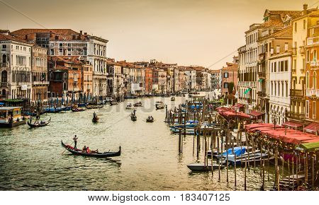 Panoramic View Of Famous Canal Grande From Famous Rialto Bridge At Sunset In Venice, Italy With Retr