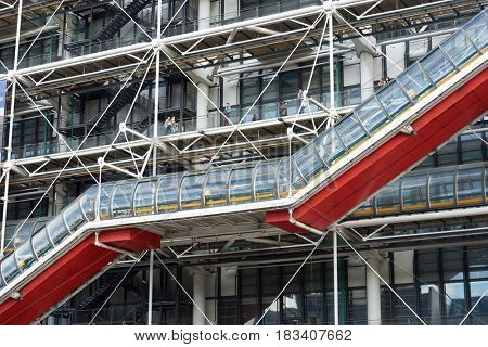 Paris, France - August 21, 2014: exterior  view of the famous Pompidou Center. Tourists walking. This museum is dedicated to the exhibition of  modern art.