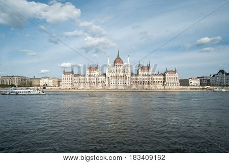 Hungarian Parliament Building known as the Parliament of Budapest. It lies in Lajos Kossuth Square on the bank of the Danube river.