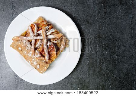 Apple galette, pie, tart with cinnamon on a grey stone background Top view with copyspace