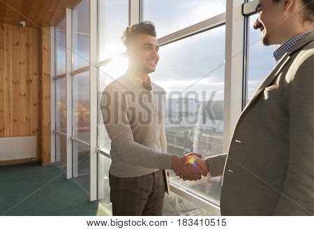 Two Business Man Shake Hand Agreement Coworking Center Business Team Coworkers Stand In Gront Big Panoramic Window Modern Office