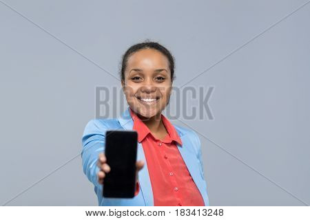 Young Business Woman Show Cell Smart Phone Empty Screen African American Girl Happy Smile Businesswoman Isolated Over Gray Background