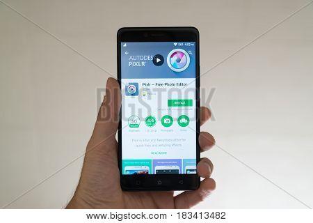 Paris, France, april 22, 2017: Pixlr application on google play store on smartphone