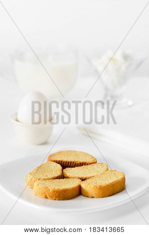 Toasts of white bread for Breakfast, milk with cottage cheese and egg. High key, selective focus.