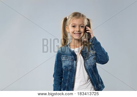 Little Teenage Girl Talking Cell Smart Phone Call, Small Kid Happy Smiling Child Isolated Over Gray Background
