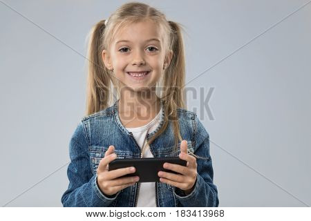 Little Teenage Girl Using Cell Smart Phone, Small Kid Happy Smiling Child Isolated Over Gray Background