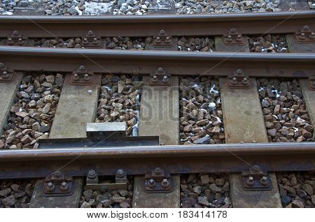 Railway track with ballast sleepers and fixing mechanisms in The Netherlands