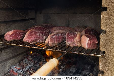 Close On Many Pieces Of Salted Picanha Barbecue Beef From Brazil Grilled On Wood Fire Still A Bit Ra
