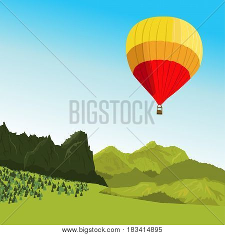 Hot air balloon flying above the mountains in the summer