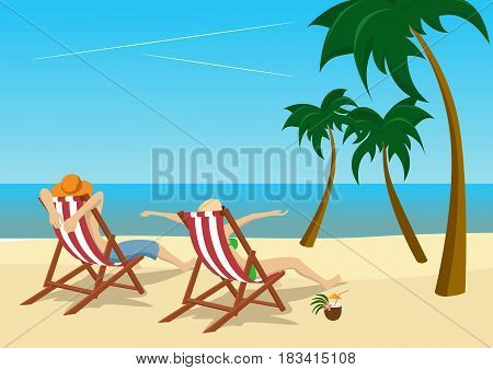 couple sitting in deck chairs on the beach at tropical resort