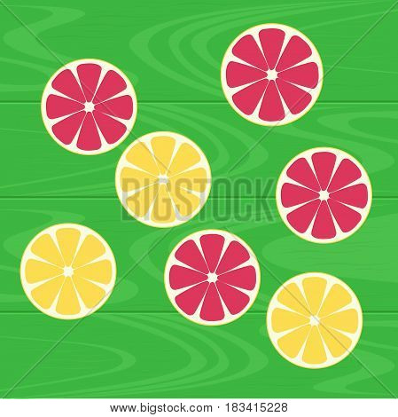 Slices of lemons and grapefruits on a green wood table. Healthy eating with natural vitamins.