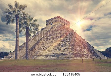 Famous El Castillo pyramid (The Kukulkan Temple feathered serpent pyramid) at Maya archaeological site of Chichen Itza in Yucatan Mexico retro effect