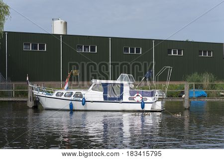 white yacht in the almelo harbor in the netherlands