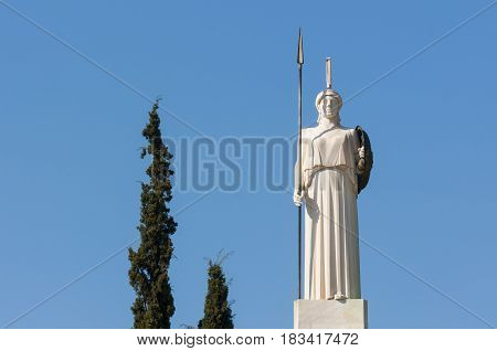 classical Athena statue with blue sky behind