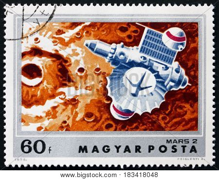 HUNGARY - CIRCA 1974: a stamp printed in Hungary shows Mars 2 over Mars Exploration of Mars circa 1974