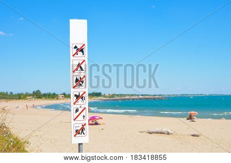 Warning on the beach that is forbidden doing