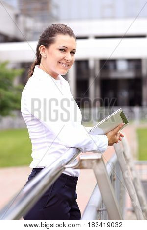 Portrait of a successful business woman smiling. Beautiful young female executive in an urban setting