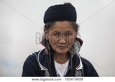 Sa Pa, Vietnam - 15 March, 2017: Portrait of unidentified woman of the Black Hmong Ethnic Minority People in Sapa, Vietnam