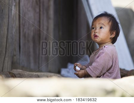 Sa Pa, Vietnam - 14 March, 2017: Unidentified ethnic Hmong minority baby portrait in the rural area of Sa Pa, Northern Vietnam, near the border with China.