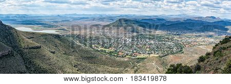An panoramic view of Graaff Reinet as seen from the toposcope near the Valley of Desolation viewpoint. The town lies in a horseshoe bend of the Sundays River