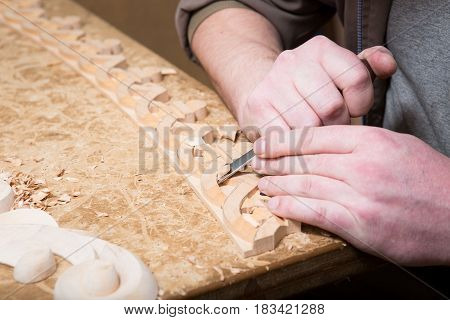 Woodcarver Creates A Furniture Ornament. Woodcarver's Hands, Chisels, Tools, Wood-carved Ornament.