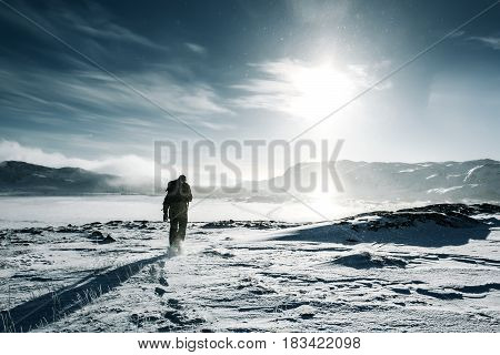 Man Traveler With Backpack At Winter Mountain