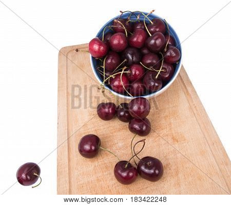 red cherries in loose form and in a bowl isolated on white background