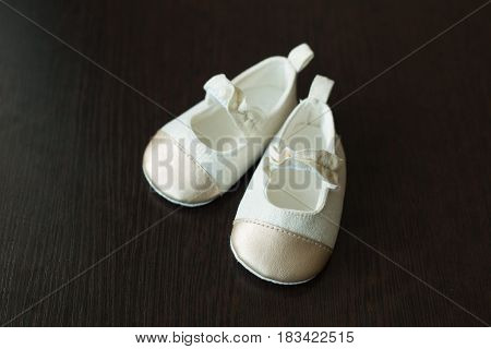 Beautiful original children's shoes for a small child of white color