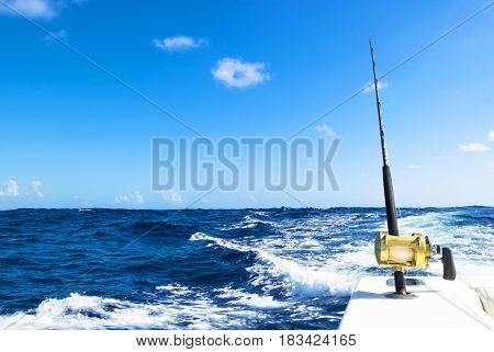 Fishing rod in a saltwater boat during fishery day in blue ocean