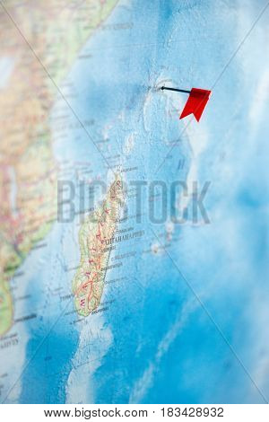 red pin flag on the world map