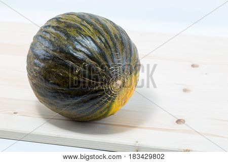 Santa Claus Melon On A Pine Wood Table Board