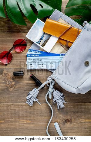 tourist lifestyle with flight tickets and glasses on wooden table background top view