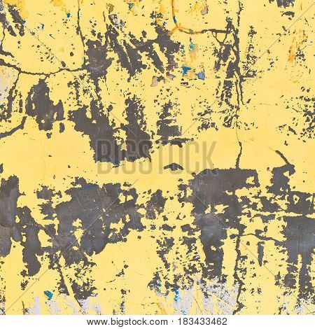 Background texture of a yellow colored old wall. Weathered surface. Close up.