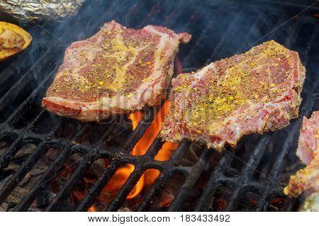 Grilled pork steaks on the grill pork steak fire